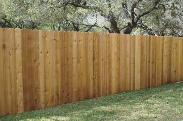 simple-wood-fence-in-backyard-that-looks-clean-and-simple-with-stained-wood-planks